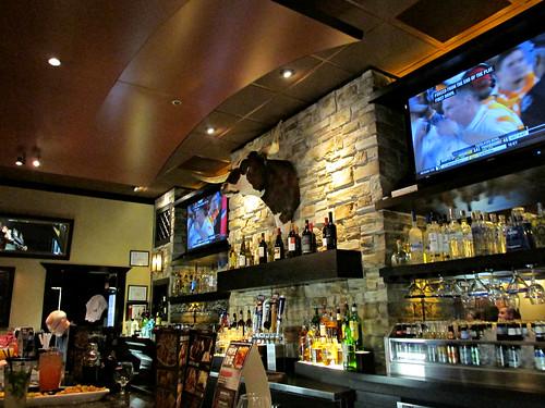A Longhorn steer head above the bar