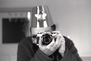 reflected self-portrait with Minolta XG-M camera and gold hat