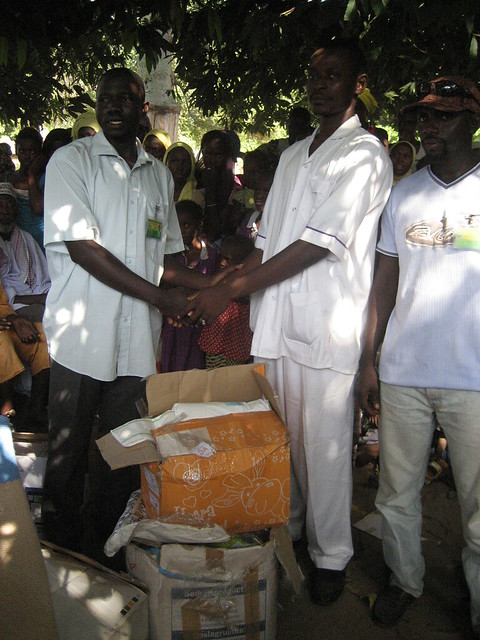 Masaneh Camara receiving the boxes of medical goods