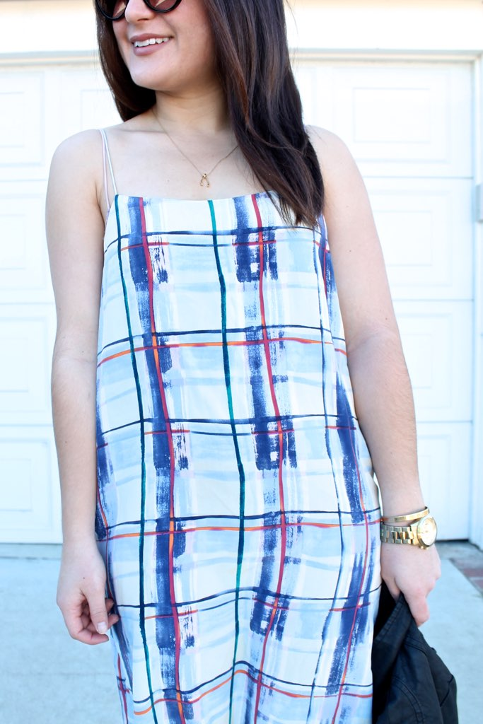 Joie plaid slip dress and gold accessories
