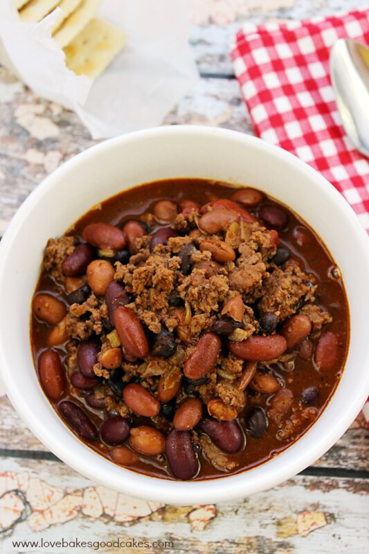 Deana's Five Bean Chili in a white bowl with a pack of saltine crackers.