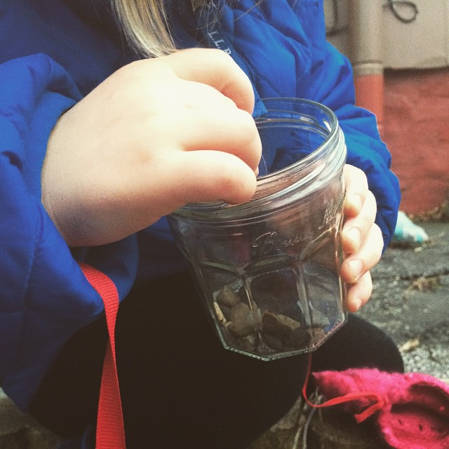 Filling her jar, pebble by pebble.