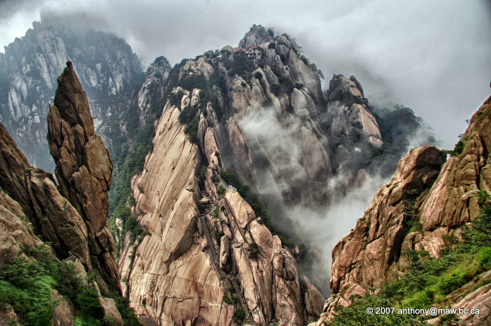 China - Mount Huangshan National Park. china, travel, mountains, tourism, misty, clouds, stairs, heaven, hiking, climbing. buy photo