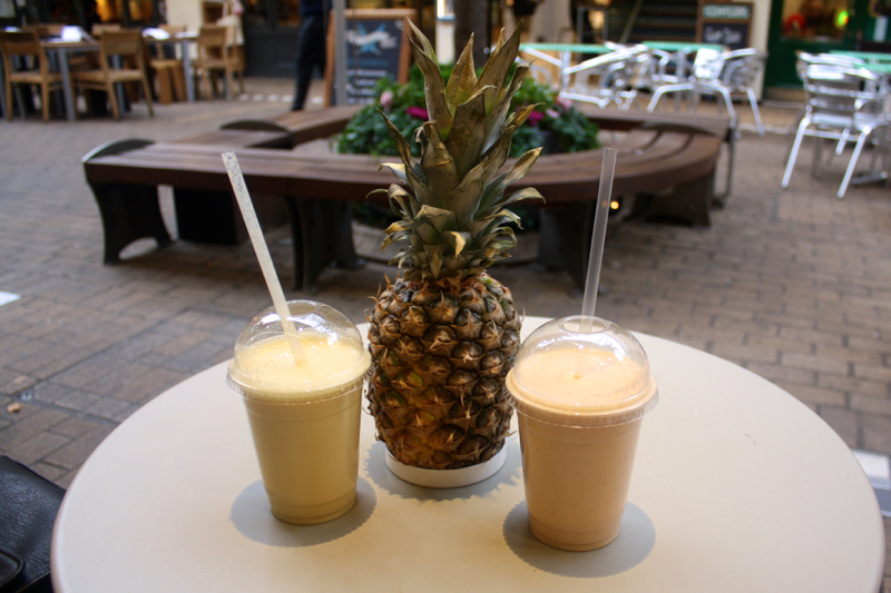 Smoothies and a pineapple at Moosh Smoothie shop in Kingly Court, Carnaby Street