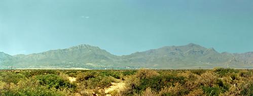mountains landscape scenery texas desert brush elpaso 1995 scrub clearsky mountainrange printscan compositephotograph