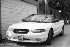 family car(0.0), full-size car(0.0), automobile(1.0), automotive exterior(1.0), executive car(1.0), vehicle(1.0), chrysler sebring(1.0), automotive design(1.0), mid-size car(1.0), compact car(1.0), chrysler(1.0), bumper(1.0), sedan(1.0), land vehicle(1.0), luxury vehicle(1.0), convertible(1.0),