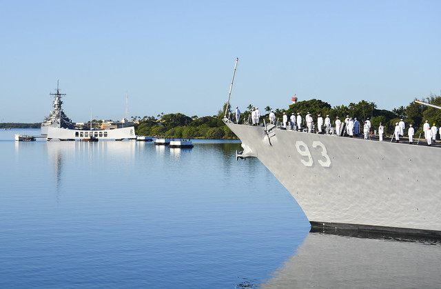 PEARL HARBOR (Dec. 7, 2014) The guided-missile destroyer USS Chung-Hoon (DDG 93) conducts a pass-in-review by the USS Arizona Memorial during the 73rd anniversary Pearl Harbor Day commemoration ceremony at the Pearl Harbor Visitor Center.