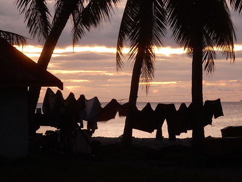 tuvalu funafuti silhouettes tropical washing drying hanging breeze wind