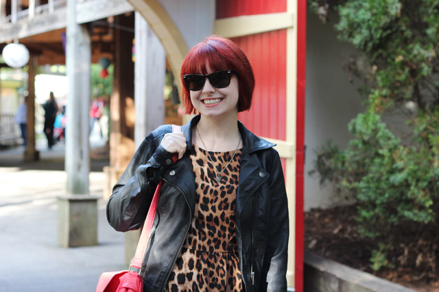 Leather jacket, leopard print dress, short red hair