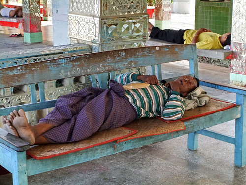 Sleeping in the Heat of the Day at a Winged God on a Pagoda in Mandalay, Myanmar