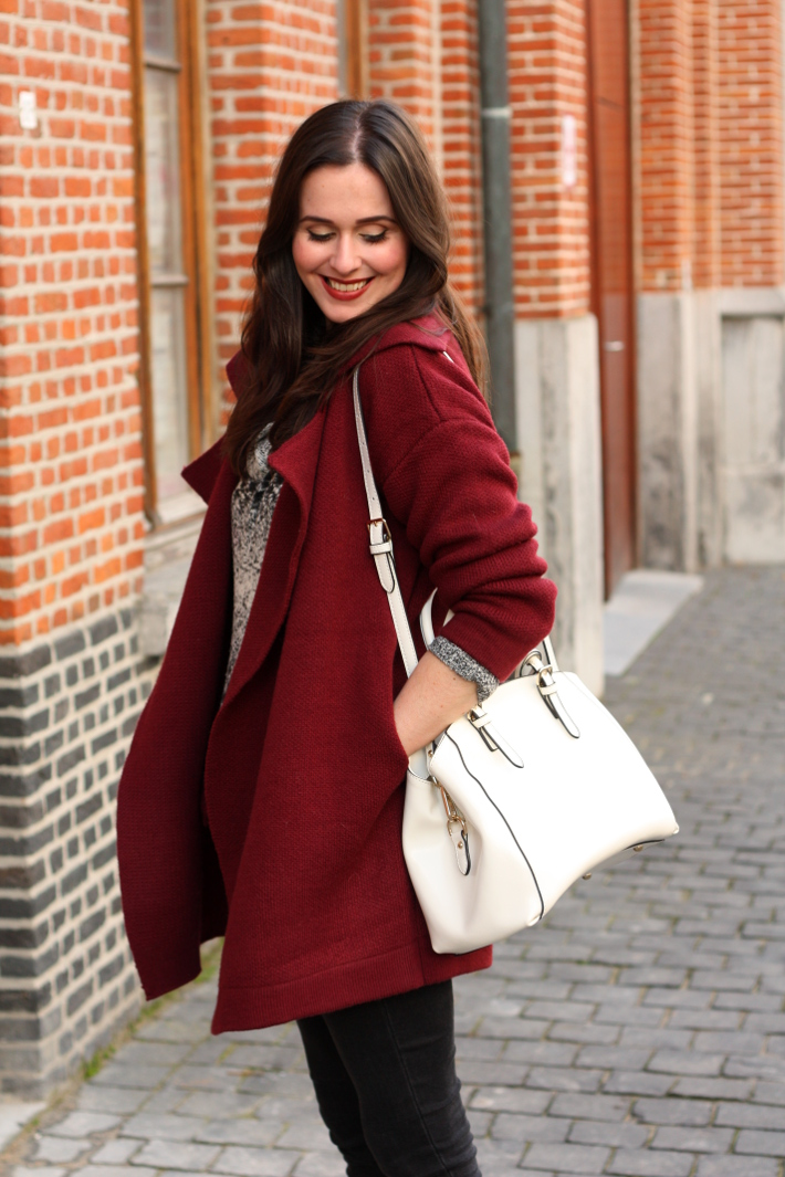 burgundy cardigan, white purse