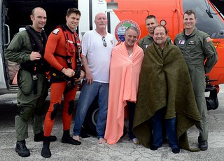 Crewmembers from an MH-60 Jayhawk helicopter pose with three survivors at Airstation Clearwater, Fla., Dec. 30, 2014. The aircrew rescued the men after their 27-foot fishing boat sank 23 miles west of Steinhatchee River, Fla. (U.S. Coast Guard photo by Petty Officer 3rd Cass Ashley J. Johnson)