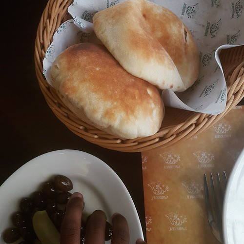 Pita bread so warm and fluffy and sweet.  Amazing.  I need me an oven pit... #breakfast  #vscocam #dubai #dbx #Lebanese #Lebanesecuisine #breads