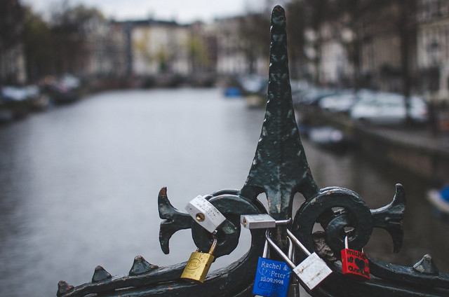 Love locks on a canal bridge near Amsterdam's Spui Book Market.
