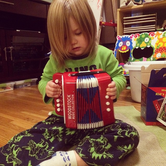 Her favorite Soltice gift came from my grandparents - a REAL (toddler-sized) accordion. Oh my!