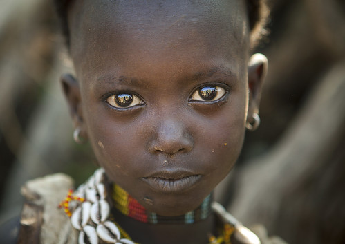 Litte Hamer Girl Tribe With Head Half Shaved  In Traditional Outfit, Turmi, Omo Valley, Ethiopia