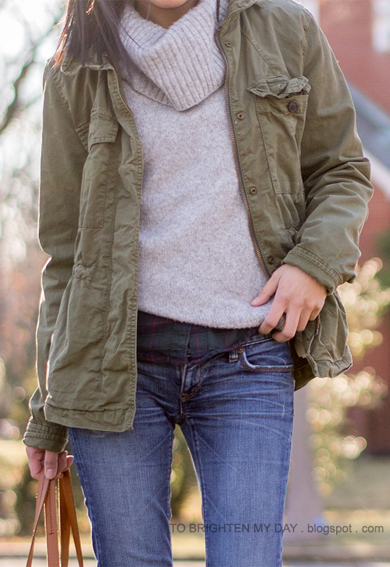 green military jacket, gray turtleneck sweater, green plaid shirt