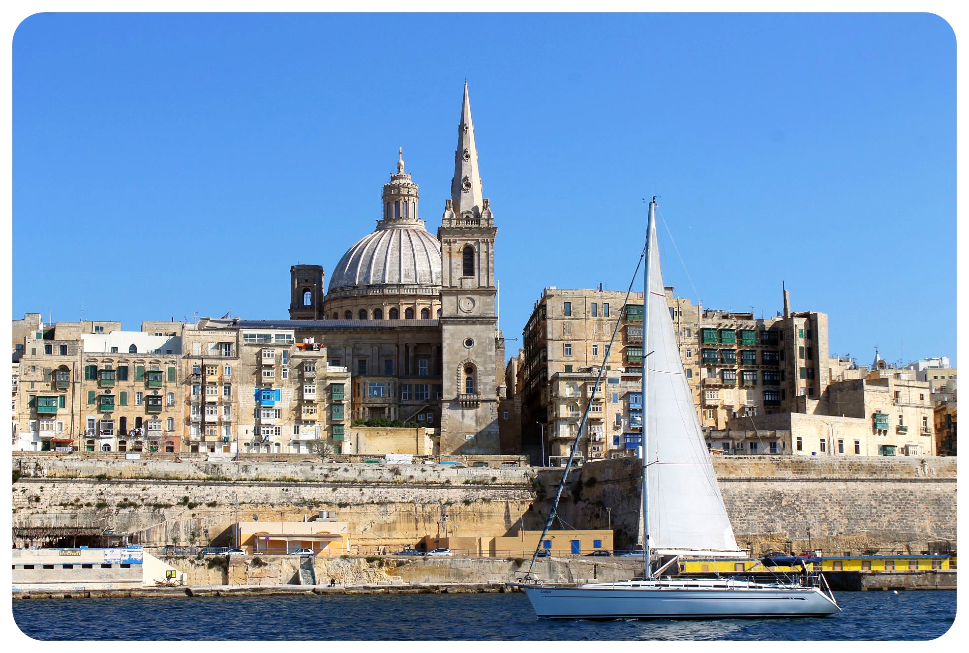 valletta churches and sailboat