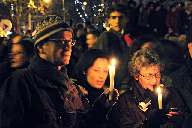 Lighting a candle at the Paris Rally of January 11th