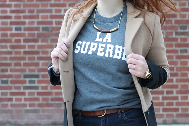 "La Superbe outfit: Madewell et Sézane ""La Superbe"" sweatshirt, skinny jeans, Jeffrey Campbell ""Cast & Crew ankle boots,"" Madewell wooden collar necklace, Madewell ""Colorblock Streetcar coat,"" Noir jewelry Dinosaur bone rib cage cuff bracelet"