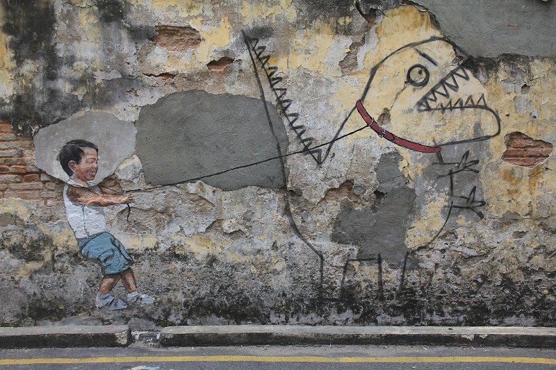 little-boy-with-pet-dinosaur-mural