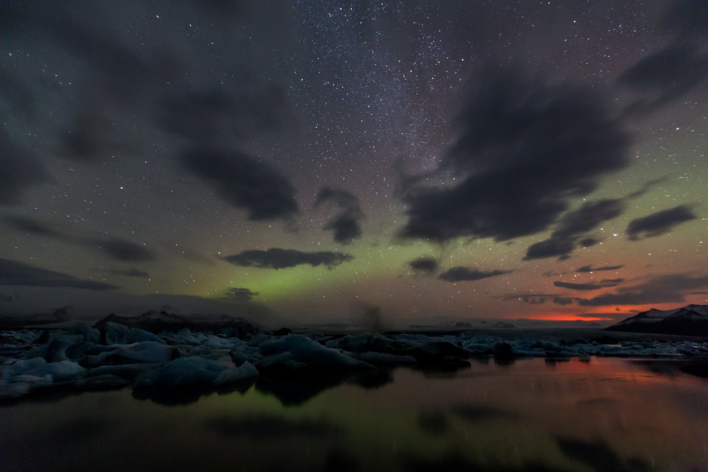 The Aurora Borealis and the light from Bárðarbunga Volcano at Jökulsárlón ice lagoon at 04.13am