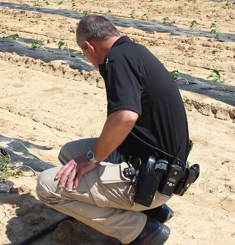 Hopkins County, Kentucky jailer Joe Blue inspects irrigation pipeline at the jail's garden. The jail's gardening program offers inmates the opportunity to work outside planting, growing, and harvesting food for hundreds of people. NRCS photo by Christy Morgan.