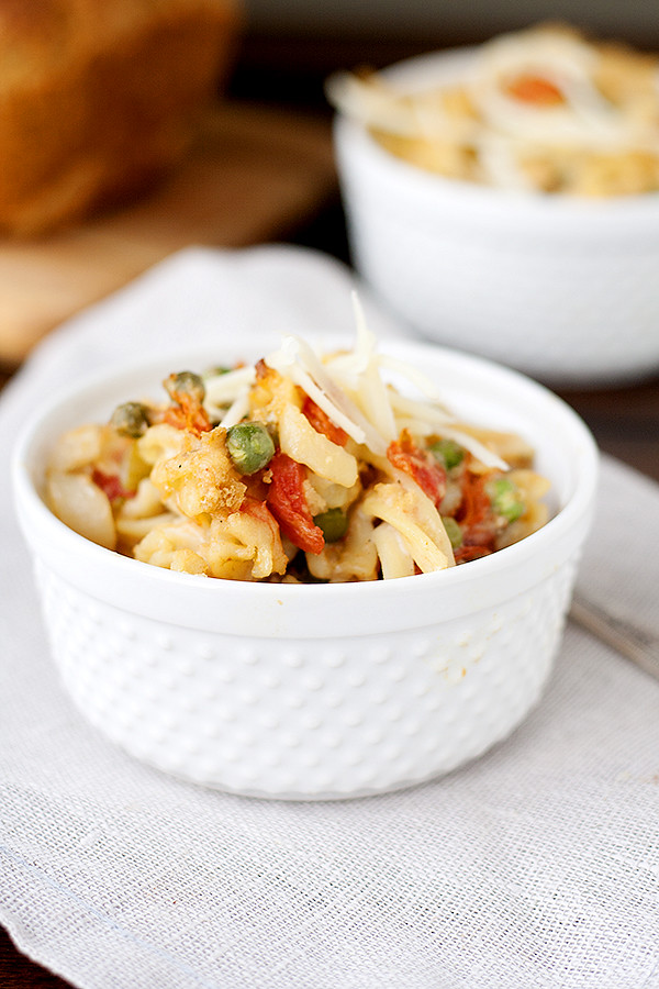 creamy pasta with chicken, tomatoes, and peas