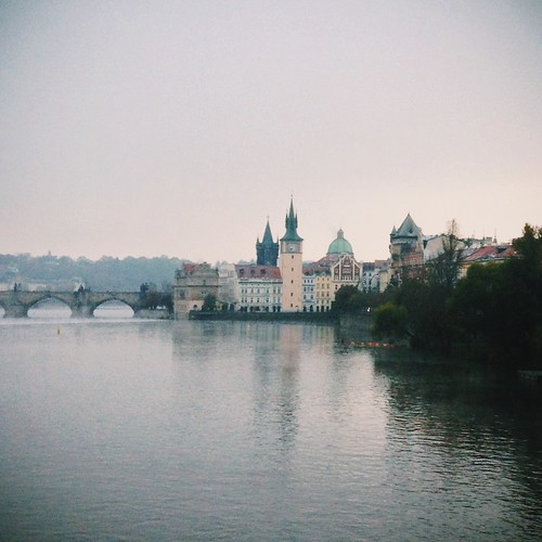 Prague's iconic Charles Bridge on a misty morning in the Czech Republic.