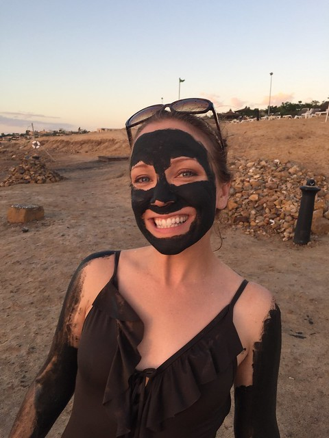 Rachelle in Jordan wearing a bathing suit (and also covered in mud) at the Dead Sea.