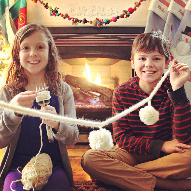 Making wooly snowball garland with i-cord  & fork pompoms!