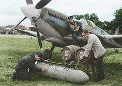 WW2 Colourised Photos: Tangmere, Sussex, July 1944: in front of a Spitfire IX of 332 (Norwegian) Squadron, a standard 45 gallon Typhoon/Hurricane 'Torpedo' jettison tank modified for use on the Spitfire (because of an expected shortage of 45-gallon shaped
