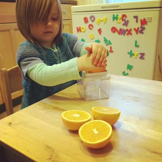 Enjoying her new juicer (which has interchangeable plates, and can also be a grater).