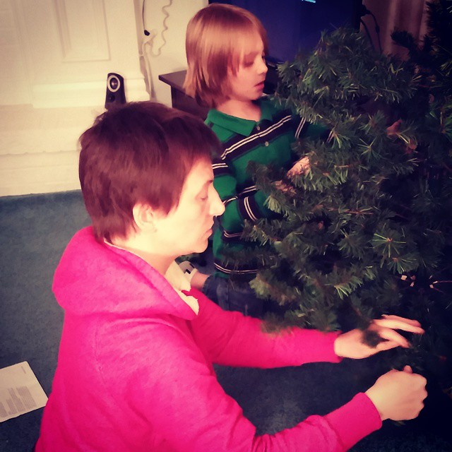 H and Mom setting up the tree