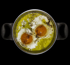 Fried eggs with olive oil
