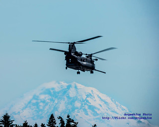 A MH-47G Chinook Soars With Mount Rainier in the Background