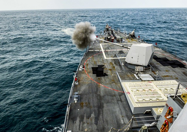 ARABIAN GULF - The guided-missile destroyer USS Sterett (DDG 104) conducts a live-fire exercise with its MK 45 5-inch 54/62 caliber gun.