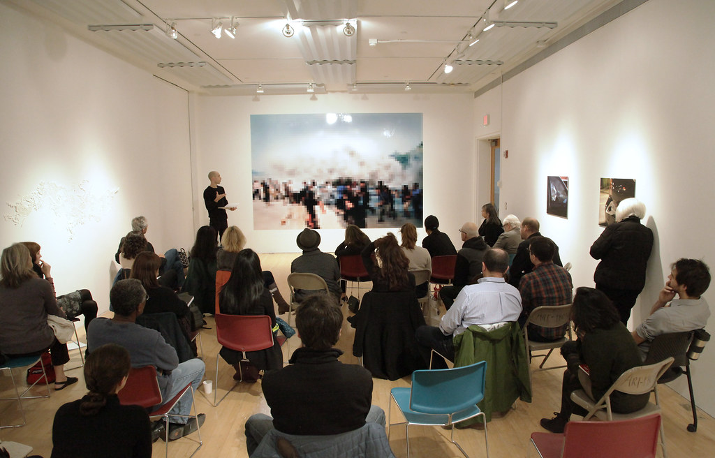 Faculty and students during the critique in the Tjaden Gallery.