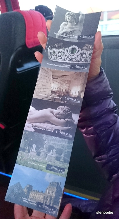 hand holding Louvre tickets