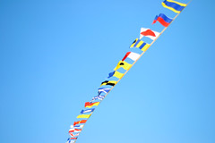 kite sports(0.0), flag of the united states(0.0), toy(0.0), line(1.0), flag(1.0), sky(1.0),