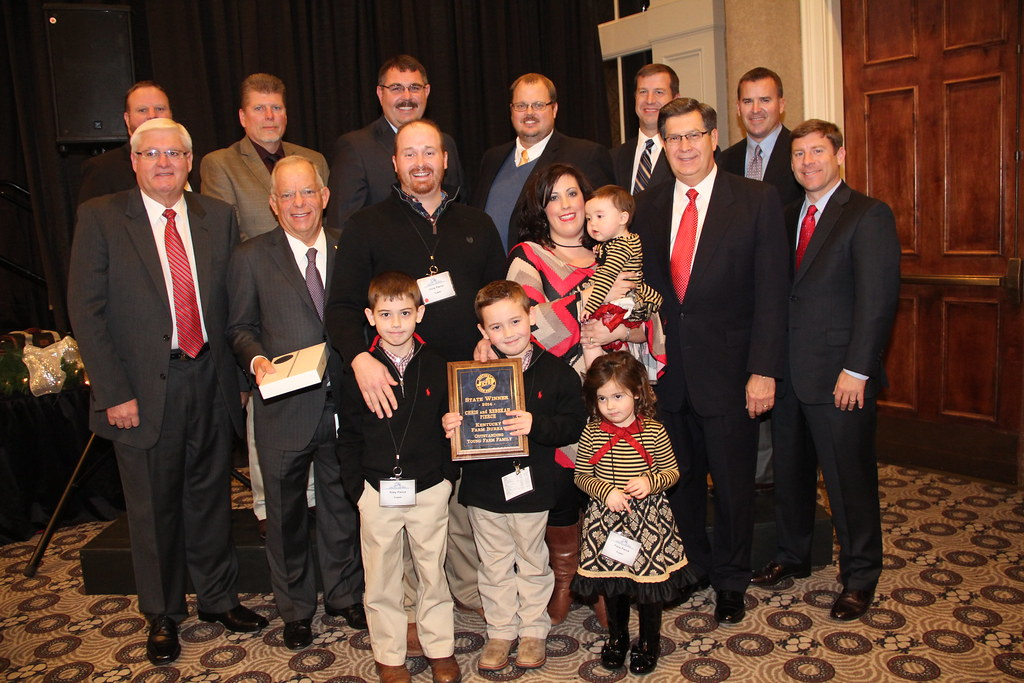 Chris and Rebekah Pierce (center) received the 2014 Outstanding Young Farm Family award
