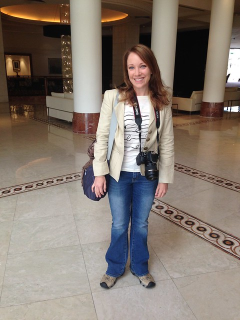 Rachelle in Jordan wearing jeans, a blazer, and hiking shoes.