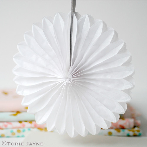 Small white tissue paper fan