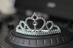 clothing(0.0), black-and-white(0.0), headgear(0.0), crown(1.0), jewellery(1.0), headpiece(1.0), tiara(1.0),
