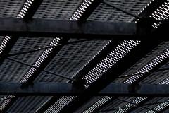 tire(0.0), automotive tire(0.0), tread(0.0), font(0.0), computer keyboard(0.0), metal(1.0), mesh(1.0), line(1.0), monochrome photography(1.0), monochrome(1.0), black-and-white(1.0), black(1.0),