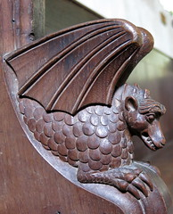 A dragon bench-end carving, the Church of St Andrew, Westhall, Suffolk, England
