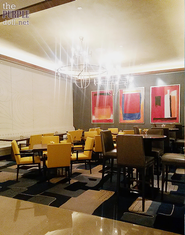 Seating area at Solaire Theatre's Snackbar