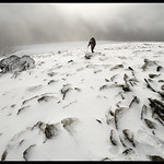 Trekker in high winds on Pen Yr Ole Wen