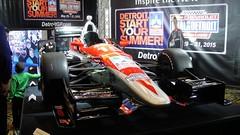 sport venue(0.0), performance car(0.0), pit stop(0.0), race track(0.0), supercar(0.0), auto racing(1.0), automobile(1.0), automotive exterior(1.0), racing(1.0), vehicle(1.0), sports(1.0), open-wheel car(1.0), motorsport(1.0), auto show(1.0), indycar series(1.0), formula one(1.0), formula one car(1.0), sports car(1.0),