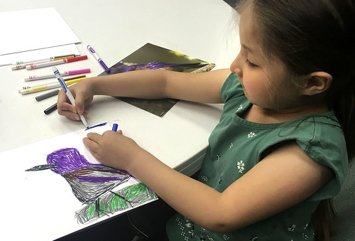 Lilac Ann Roehl, 6, works on a painting of a bird during a children's art workshop hosted by the Kenaitze Indian Tribe on April 23 at the Kenai Visitor and Cultural Center.